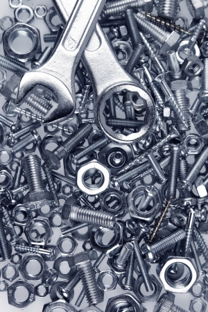 Two spanners on nuts and bolts photo