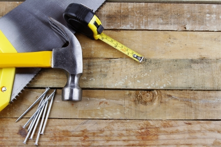 lumber industry: Assorted work tools on wooden decking Stock Photo