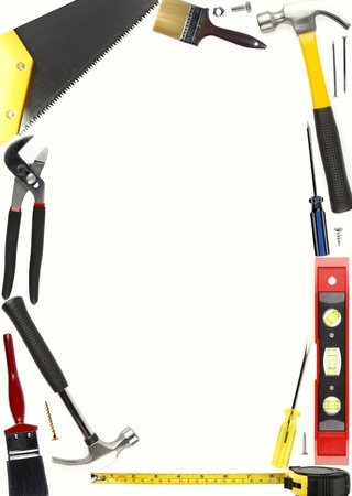Assorted work tools on plain background photo