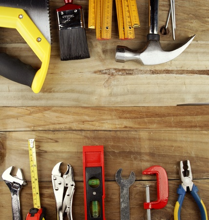 Assorted work tools on wood Stock Photo - 14240823