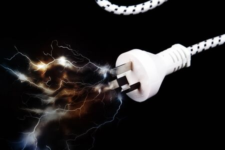 Electric plug on black with sparks Stock Photo - 14436023