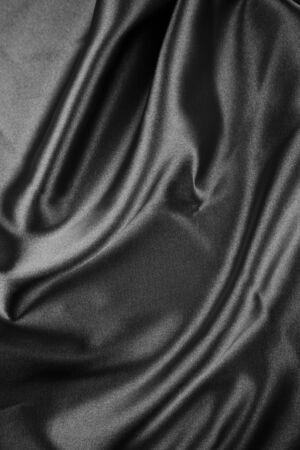black satin: Closeup of folds in black silk fabric