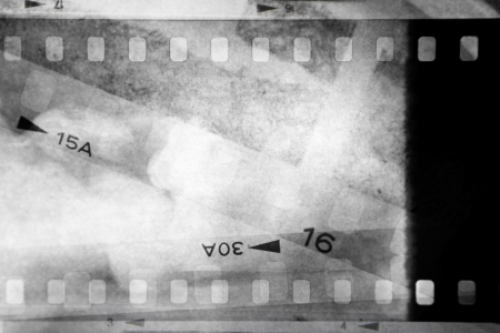 Film negatives overlapping, black and white photo