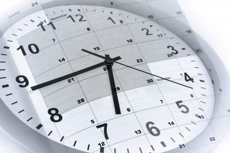 Face à l'horloge et la page calendrier Banque d'images