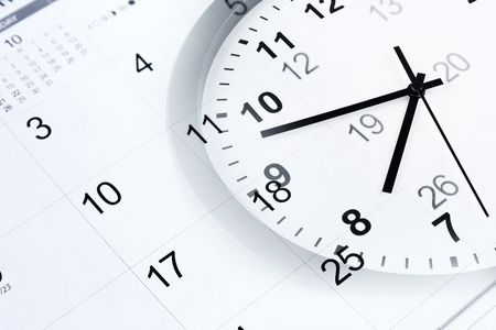 punctuality: Clock face and calendar page