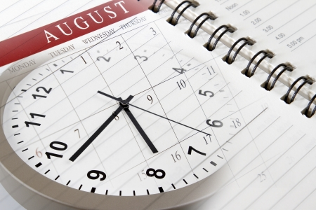 Clock face, calendar and diary page photo