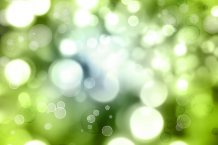 blurry lights: Circles of light on green background Stock Photo