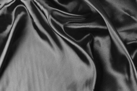 black silk: Closeup of folds in black silk fabric