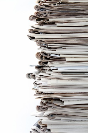 Closeup of stack of newspapers on white photo