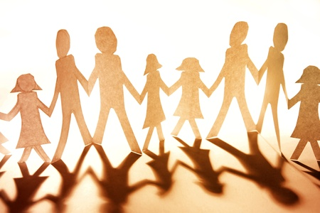 Group of people together holding hands photo
