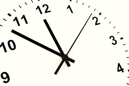 midday: Hands pointing to midday on clock face Stock Photo