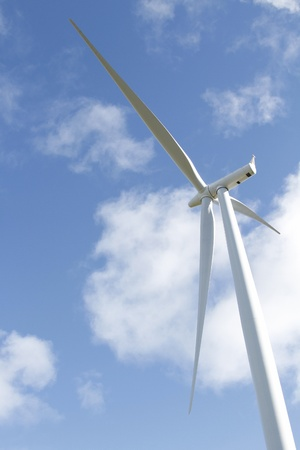 power in nature turbine: Closeup of wind turbine and blue sky