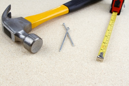 Hammer, nails and tape measure. Copy space photo