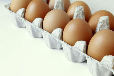 Closeup of eggs in carton photo