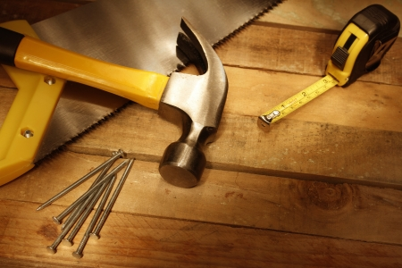 Assorted work tools on wood Stock Photo - 14842926