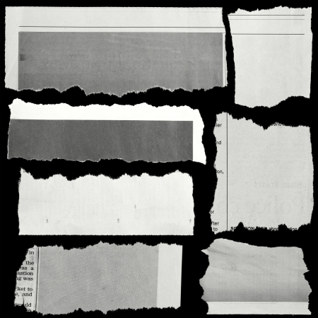 teared paper: Pieces of torn paper on black  Copy space