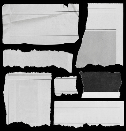 paper cutting: Pieces of torn paper on black  Copy space