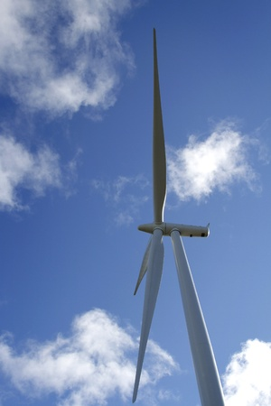Wind turbine blades and clouds photo
