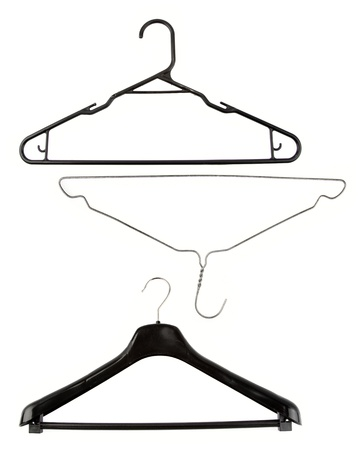 coathanger: Three coat hangers on plain background