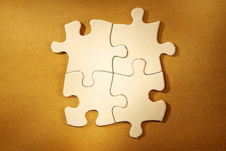 Four jigsaw puzzle pieces connected photo