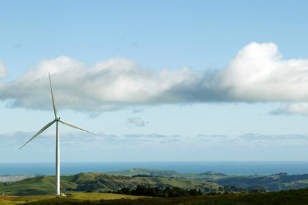 wind turbines: wind turbine on hill  Coastline in background