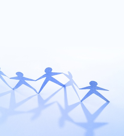 Team of paper doll people holding hands  Teamwork concept Stock Photo - 15127971