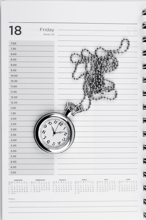 timepiece: Pocket watch on diary page