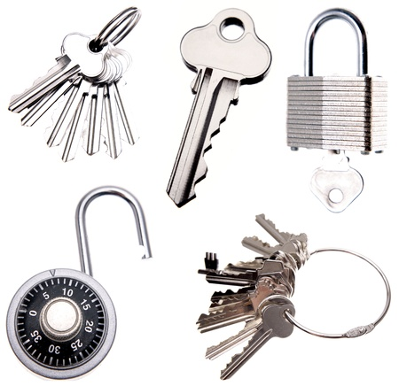 white key: Collection of keys and locks on plain background