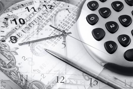 accountancy: Calculator, pen, clock hands and money