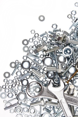 Wrenches, nuts and bolts on plain background Stock Photo