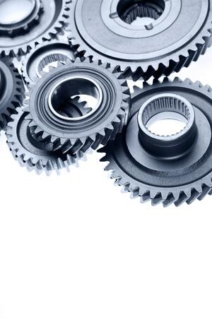 cog wheels: Closeup of metal gears on plain background