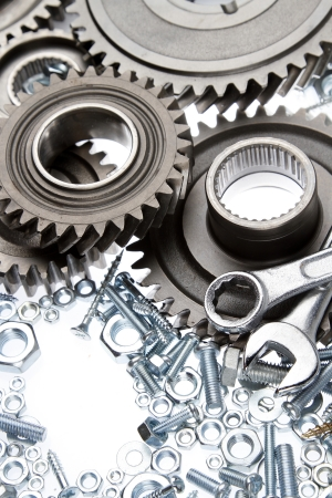 Steel gears, nuts, bolts, and wrenches Stock Photo - 15609089