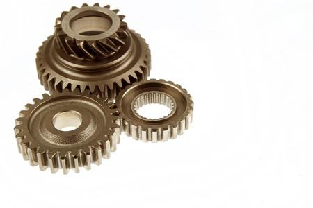 three wheel: Closeup of metal gears on plain background