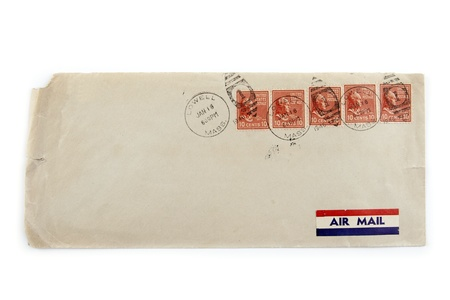 Stamps and air mail label on old envelope. 1946 photo
