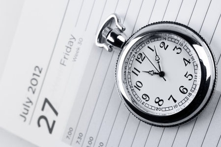 time management: Pocket watch on diary page  Stock Photo