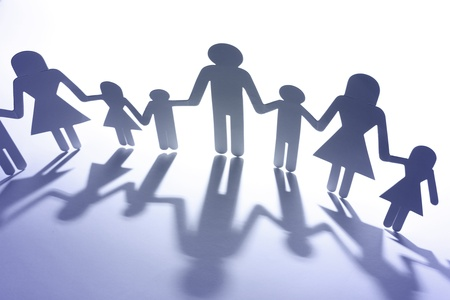 unity is strength: Paper doll family holding hands. Copy space Stock Photo