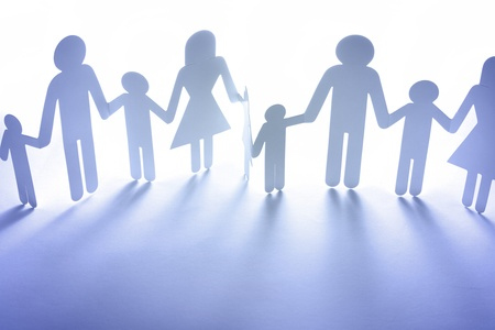 group chain: Paper doll family holding hands. Copy space Stock Photo