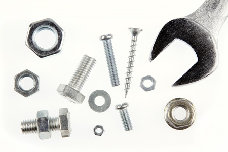 Spanner, nuts and bolts on plain background Stock Photo - 15846220