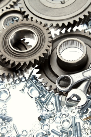 gearing: Steel gears, nuts, bolts, and wrenches