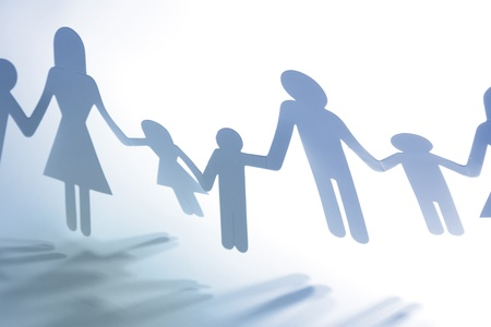 Paper doll family holding hands Stock Photo - 15877635