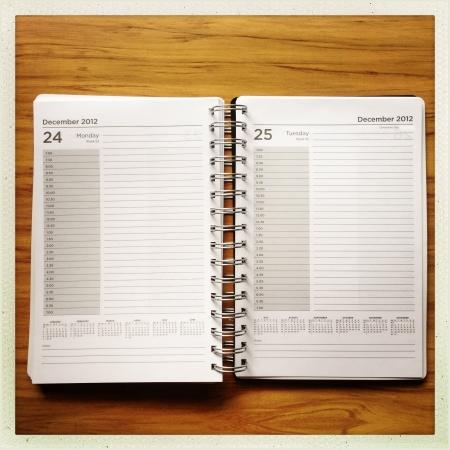 organizer page: Open diary on desk Stock Photo