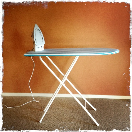 Iron on top of ironing board Stock Photo - 16173754