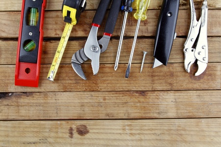 workbench: Assorted work tools on wood  Directly above