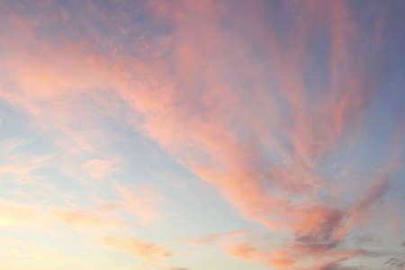 Orange color clouds in sunset sky photo