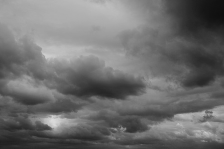 Dark ominous grey storm clouds. Dramatic sky. Stock Photo