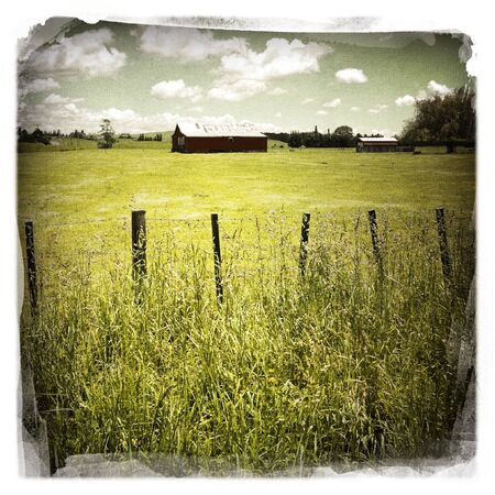 old red barn: An old red barn in rural scene Stock Photo