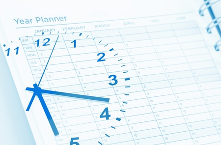 Clock face and page of year planner photo