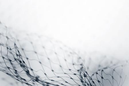 redes de pesca: Primer plano de rejilla abstracta sobre fondo blanco