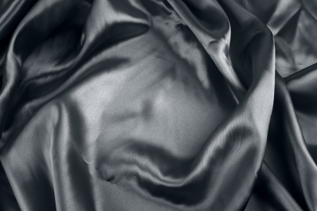 Closeup of folds in black silk fabric  photo