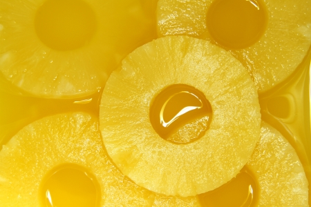 pineapple slice: Closeup of pineapple slices in natural juice
